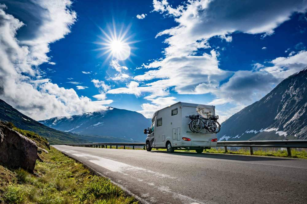 RV on the highway in beautiful landscape