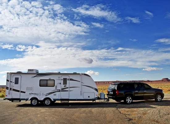 Travel Trailer Pulled by a Large SUV, in Arizona, USA